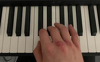 fingering for black keys on the piano thumb